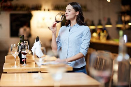 depositphotos_187889882-stock-photo-modern-sommelier-estimating-smell-red
